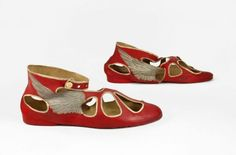 Swimming shoe, made by Philips, English, late 1920s--The 1920s saw increasing numbers of women participating and excelling at sports. The sporting accomplishments of women, inspired many women to take up a sport. This pair of red rubber 'silver wing' bathing shoes would have been worn by a swimmer in pursuit of both fashion and fun around the end of the decade. (2011 Bata Shoe Museum, Toronto, Canada)