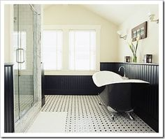 Love the black wainscoting w/the black tub splish-splash