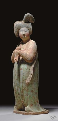 Tang Dynasty (618-907) ~ A painted pottery figure of a courtier.