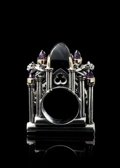Ring   Willliam Llewellyn Griffiths. 'Cathedral'  Sterling silver, 9ct yellow gold, a central labrodorite stone and smaller amethyst stones