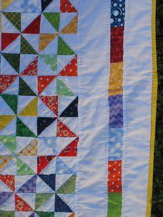 Spinning Rainbows Pinwheel Quilt Close up by Koshka2, via Flickr