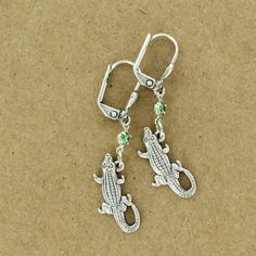 Sadie Green's rhinestone alligator earring
