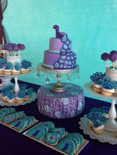 Peacock cake, peacock cupcakes (do like the turkey cupcakes with chocolate), and peacock cookies. Peacock Cupcakes, Peacock Cake, Peacock Wedding Cake, Peacock Theme, Purple Peacock, Wedding Cakes, Peacock Party Ideas, Peacock Design, Peacock Feathers