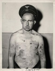 1944- His body bruised and muddied, giving evidence of the rough handling he received from patriots who turned him in, the mayor of Olloy scowls into the camera. During his term in office he worked for the Gestapo and was responsible for the arrest of Belgian youths.