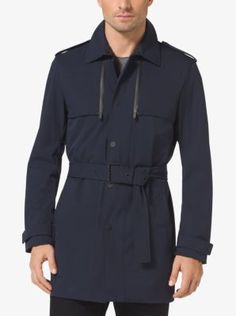 Keep rain at bay without sacrificing style thanks to our sleek trench coat. Expertly crafted in waterproof stretch-nylon, it features traditional details like shoulder epaulettes and a belted waist, while a shorter length and slim fit speak to modern style.