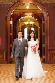 The ceremony took place within the Crocker Art Museum's Ballroom. Photographer: Liz Caruana Weddings.