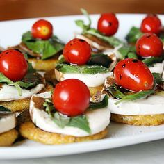 CAPRESE POLENTA BITES  INGREDIENTS 1 16 ounce tube (herbed) polenta, cut into ½-inch slices ½ pound fresh mozzarella, cut into ¼-inch slices grape tomatoes (or cherry tomatoes sliced in half) 1 small bunch fresh basil, leaves divided from stems ½ cup balsamic vinegar olive oil, for drizzling salt and pepper to taste   source =>   CAPRESE POLENTA BITES