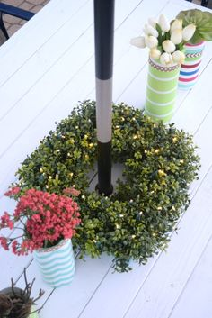 green wreath, Outdoor living and ideas to enjoy your patio at night. A few simple additions turns this outdoor space into an oasis, helping to light up the night. To see more click the link or visit- http://ourhousenowahome.com/