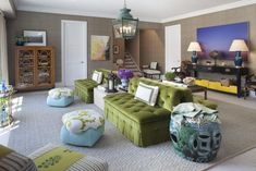 I need a green velvet sofa. Also that vignette with navy table/yellow boxes/ blue art is awesome.