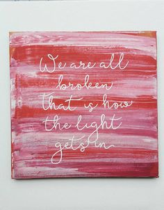 We are all broken. That is how the light gets in. Inspirational quote on a 12 x 12 framed canvas. Red and white with silver highlights $25 LCDesigns