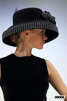 Black hat with polka dot trim.