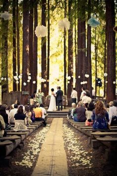 Really love this! My dream wedding would be like this. Out in the middle of the forest with trees all over, Hanging lanterns, flowers everywhere & wood benches. Perfect!