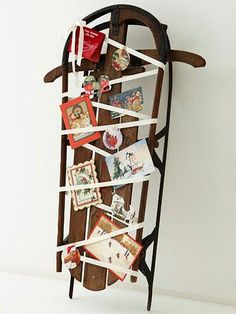 The Christmas cards you receive can become part of your holiday decor. Use this year's cards as they arrive or save them year to year. Showcase the cards on a unique surface, such as a salvaged wooden sled.