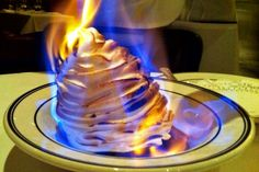 Baked+Christmas+Alaska+is+is+a+fun+Christmastime+recipe+everyone+will+enjoy.+Be+careful+when+you+flame+the+brandy.+Simply+delish!