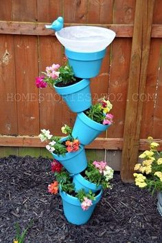 stacked pots planter | Planter and Bird Bath; variation on the theme of pots. by patrica