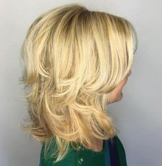 Blonde Layered Hairstyle With Side Bangs | For more style inspiration visit 40plusstyle.com