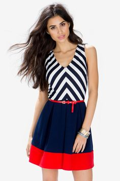 A brunch-perfect day dress, featuring a chevron printed bodice and a colorblocked skirt. V-neck. Sleeveless. Belt loops at the waist with a skinny leatherette belt. Finished short hem. Looks perfect with colorful jewelry and peep-toe platforms. $32.50