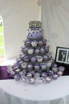 This cupcake tree is decorated with a rosette design of mixed purples and white. #wedding #weddingcakes #purple #cupcakes
