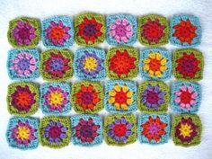 Awesome Summer Flowers Granny Square Blanket Tutorial! Anyone can learn to crochet this and have a beautiful and bright afghan to cuddle up with!