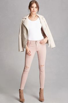 A pair of jeans featuring a distressed style, a low-rise, mock front pockets, back patch pockets, and a zip fly front. This is an independent brand and not a Forever 21 branded item.