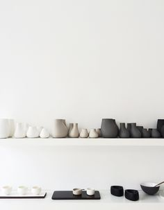 Netural display of simple ceramics by Annemette Kissow via Far And Close http://farandclose.com/keramik-og-glasvaerkstedet/