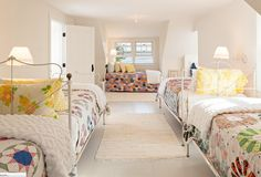 Guest bedroom with antique beds. This is a good alternative to bunk room. Alys Design.
