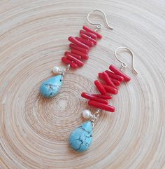 Valparaiso is a pair of earrings in summery juicy colors that will truly capture the eyes. They feature lovely red coral branches wire wrapped with sterling silver wire, white lustrous freshwater pearls and turquoise howlite smooth drop briolettes. I love how the coral branches