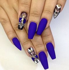 An abstract inspired dark blue nail art design. While the dominant color of the nail art design is blue, you can see that the abstract element is added on the nails with the clear polish with the help of black, white and gold polishes.