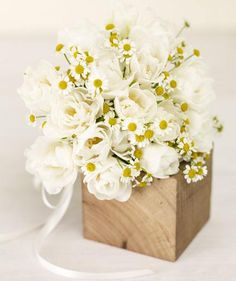 White Tulips and Chamomile | Find the perfect all-white wedding bouquet.