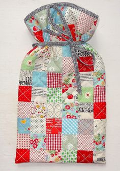 Hot water bottle cover quilted bag in modern fabrics - all from Tikki Patchwork in London including the pattern