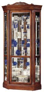 Howard Miller 680-290 Embassy II Curio Cabinet by Howard Miller. Save 30 Off!. $1302.00. Front locking door secures your collectibles. Height-adjustable floor levelers under all four corners provide stability on uneven as well as carpeted floors. Made in the USA. Plate grooves in the glass shelves allow for vertical display of plates. Halogen light with convenient No-Reach Touch-Lite light switch offers four levels of lighting: low, medium, high, and off  A handy key holder i...