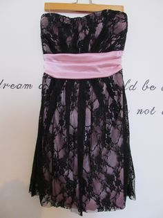 Available @ TrendTrunk.com PINK AND BLACK SHORT STRAPLESS DRESS. By Speechless. Only $23.00!