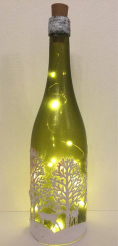 These vodka flask crafts give you a large number of methods to reuse and reinvent this everyday piece. Wine Bottle Vases, Wine Bottle Centerpieces, Painted Wine Bottles, Bottle Box, Lighted Wine Bottles, Bottle Lights, Wine Glass, Decorated Bottles, Wine Cork Crafts