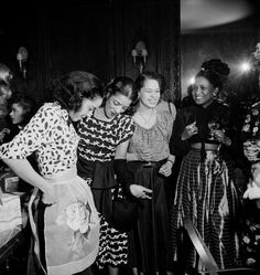 """Maria Hawkins Ellington tries on one of her gifts at a party in Harlem celebrating her marriage to Nat """"King"""" Cole in March 1948. The Coles were married at the famous Abyssinian Baptist Church in Harlem by Adam Clayton Powell, Jr. Photo by Lisa Larsen/Time Life Pictures."""