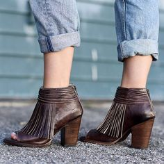 Easy, breezy, carefree days lie ahead in OLIVIA. Fun fringe accents on this natural vegetable tanned leather peep toe heel will have you skipping towards the sun. Brighten your Spring with this playful addition, OLIVIA .