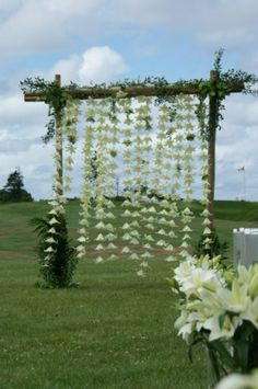 Hanging flowers for ceremony backdrop.  Simple & Pretty!