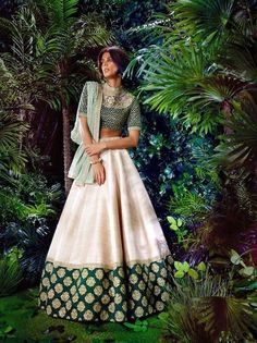 Sabyasachi is on a roll! check out this unconventional stunner for your sangeet - Stand out with its creme and emerald hues