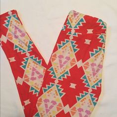 LuLaRoe red printed leggings. Amazingly soft Softest leggings ever! Great pattern. 92% cotton 8% spandex. One size will fit up to a 12-14 LuLaRoe Pants Leggings