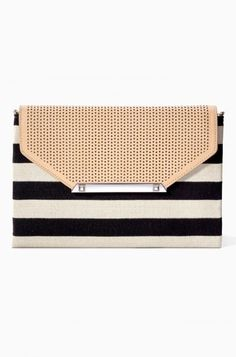 Our black envelope clutch is the perfect size to dash out for an errand or a red carpet event. Find the perfect black clutch purse from us at Stella & Dot.
