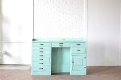 Teal Desk: A solid wood desk painted in a stunning teal. Drawers open which helps make this piece great for holding guest favors or florals.  Also great prop for photo shoots. *Paisley & Jade Vintage & Specialty Furniture Rentals for Events, Weddings, Theatrical Productions & Photo Shoots*