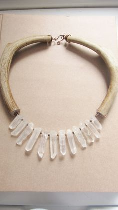 Antler Bib Necklace Rustic Jewelry Quartz Crystal Point Statement Necklace DanielleRoseBean Rustic Bib Necklace. $198.00, via Etsy.