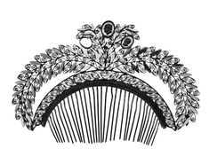 A neo-classical turned ironwork and cut steel hair ornament,