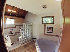 Walk-in shower and separate soaking tub. Fiji bure. Kulu Bay Resort.