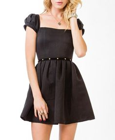 How CUTE!  I love this dress.  Would probably add a panel of gold/black brocade at the bottom cause it's too dressy to wear with leggings, but too short to wear without!