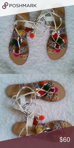 Chinese Laundry Posh Sandals (White) New Fashionable multi color sandals perfect for spring/summer. Boho style gladiator lace-up with colorful beading and pom accents. Chinese Laundry Shoes Sandals