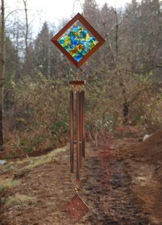 Kaleidoscope wind chime, glass and copper.
