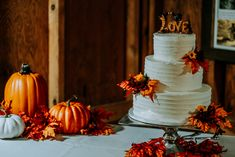 3-Tier Wedding Cake from Bradford's decorated with faux fall leaves | Smoky Mountain Wedding | National Park Wedding | Fall Wedding | Spence Cabin Ceremony | Appalachian Clubhouse Reception | Derek Halkett Photography | Absolute Wedding Perfection