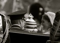 In the carriage.  Two people who never seem to run out of words to say to each other-- at the official start of their lives together as man and wife in a horse drawn carriage escorted by mounted soldiers of the Queens Household Calvery on their way to the Palace to celebrate their nuptials. Some would say that this is what fairy tales are made of!