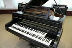 This is called a double manual piano. Yes it's real. Yes, some people do play…