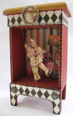 Dancing Clown box.  This is a Really Old Toy, I don't know IF This One is a Really Old One Though, as they were Reproduced in the '80s.  They are very Kool as they play muZik for your child too!  Came in a Variety of Clowns (the repro's did anyway)
